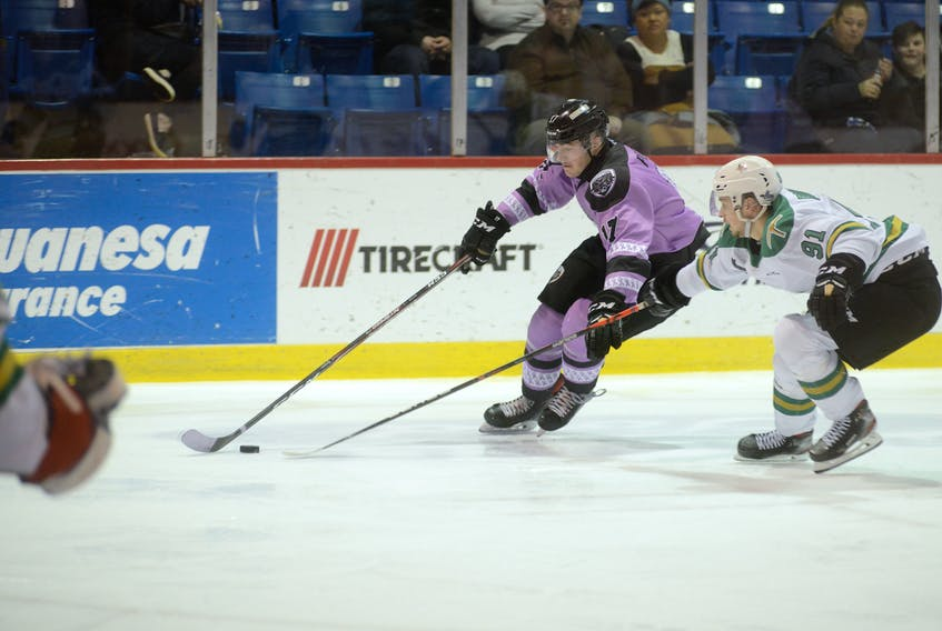 Charlottetown Islanders left-winger Liam Peyton, left, tries to beat Val-d'Or Foreurs defenceman Karl Boudrias to the outside during second period action Friday at the Eastlink Centre.