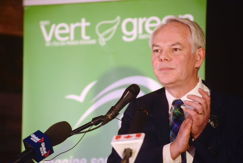 Green Leader Peter Bevan-Baker claps in support of his team at a reception party Tuesday night following the provincial election.
