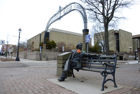 A statue of Sir. John A. Macdonald sitting on a bench is at one end of Victoria Row in downtown Charlottetown.