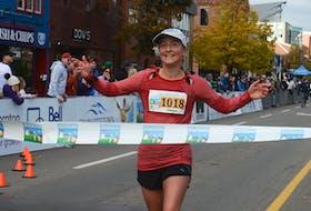 Helga Reisch-MacNeill of Kensington crosses the finish line Sunday during the P.E.I. Marathon.