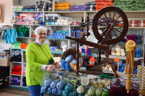 Moraff's Yarns and Crafts owner Agnes Harriss stands beside an antique sewing wheel in the yarn room of her Whitney Pier shop. Harriss says a local and loyal customer base has helped her keep the store going during the ongoing pandemic. DAVID JALA/CAPE BRETON POST