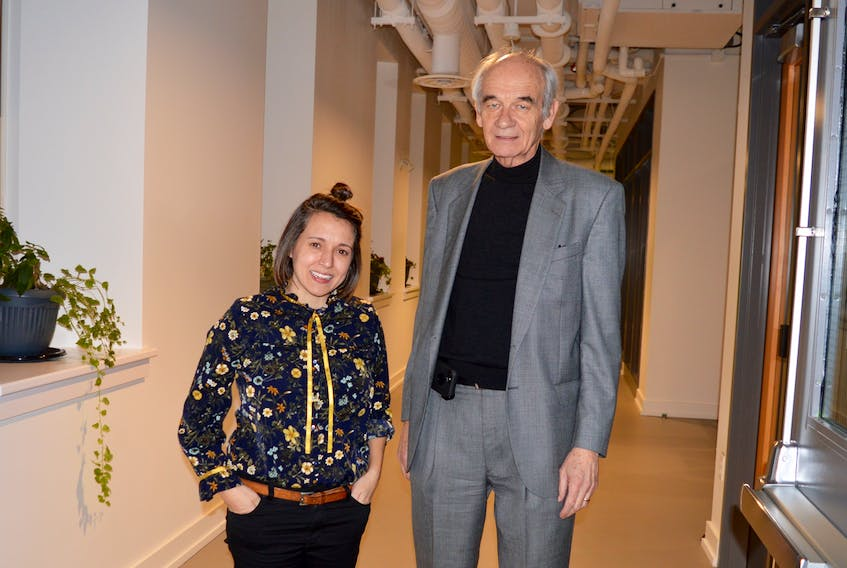 Erika Shea, left, is the new president of New Dawn Enterprises following the recent retirement of Rankin MacSween. The pair are shown in a hallway of the recently-renovated former Holy Angels Convent that the non-profit community development organization has renovated and made workspace and meeting rooms available to local artists, entrepreneurs and others.  DAVID JALA/CAPE BRETON POST