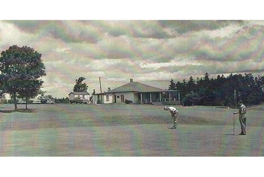 Two golfers putt out on the ninth green, sometime in the mid-1950s.