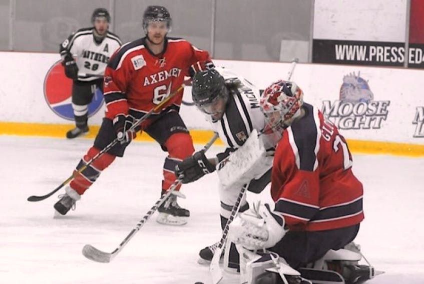 PantherCole MacMillan had one of UPEI's three goals on Acadia's Brandon Glover Nov. 21 in Charlottetown.