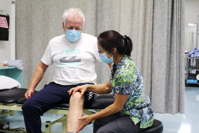 Physiotherapist Belinda Lau-Beaton performs an assessment on patient Dave MacQueen during his recent visit to the rehabilitation services department at Cape Breton Regional Hospital. - Sharon Montgomery