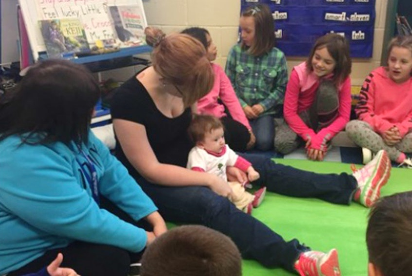 Kayleigh Roy and baby Summer Wolfe will visit a class of Grade 2/3 students at Dr. John C. Wickwire Academy in Liverpool several times over the course of the year as part of a Roots of Empathy program, helping students to learn many social skills, including empathy.