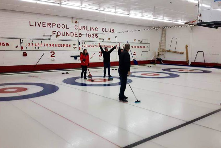 Derek Zwicker raises his arms in a cheer after he won the tie breaker against Brady's Home Hardware during a past Curl for Cancer event in Liverpool. He's standing by Sarah Horton.