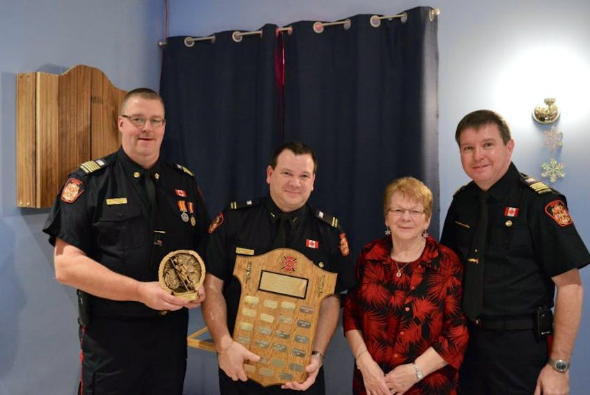 The Leonard Mills Fireman of the Year award was presented to firefighter Darrell Rice by the chief and deputy chief along with Len Mills widow Alice Mils. Pictured (from left) are Fire Chief Shawn Dalley, Darrell Rice, Alice Mills and Deputy Chief Morray Callahan.