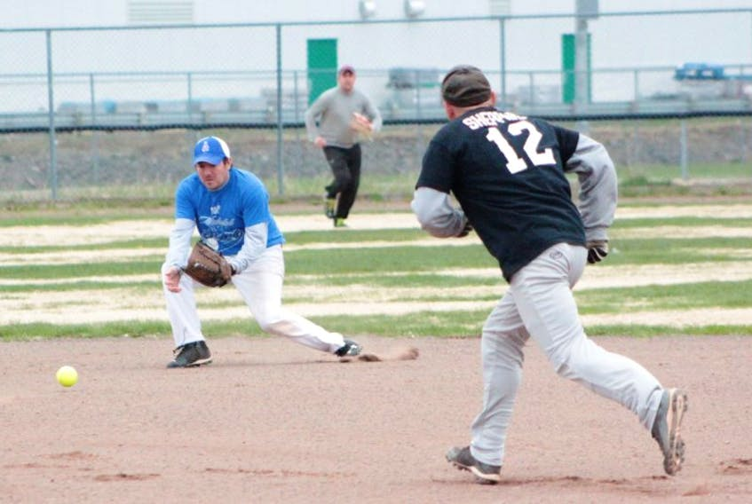 Brad Rice of Michelob Ultra Stars gets in position to pick up a hard-hit grounder during his team's May 29 game against Bennett's Eavestrough. The Stars picked up a 16-14 win in extra innings.