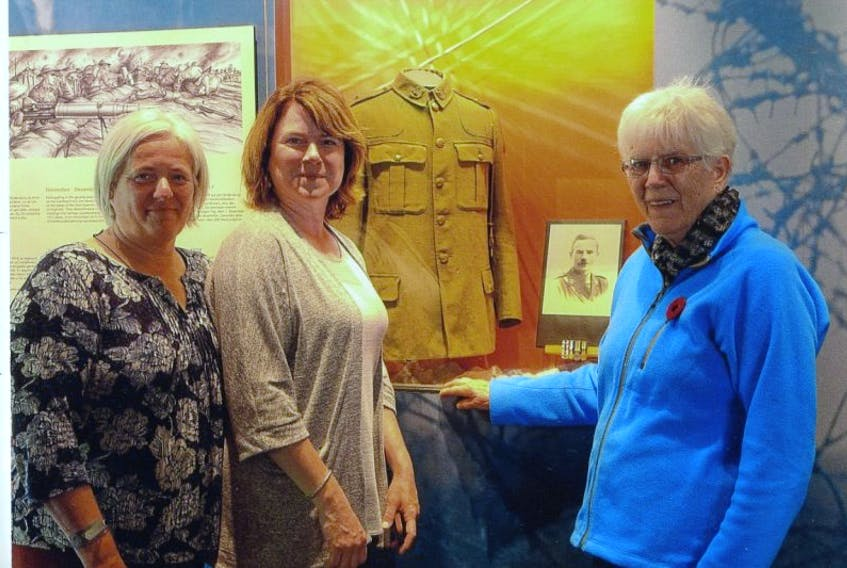 The descendants of George Hicks were proud to supply some of his military keepsakes to the Beaumont Hamel Interpretation Centre. Pictured at the display during their visit this past summer are his granddaughters Ann Bevin-Baker and Jennifer Hamilton as well as his daughter Elizabeth Walters.