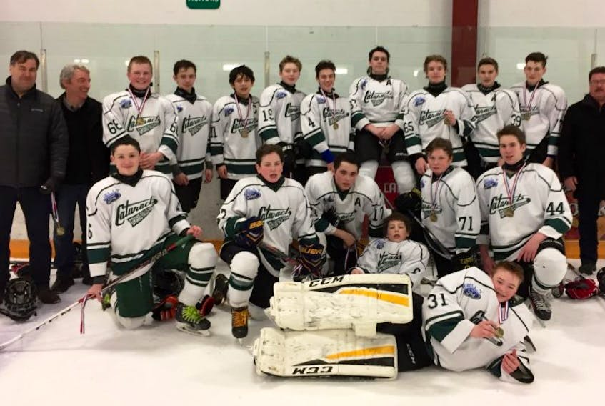 The silver medal winning Grand Falls-Windsor Bantam Cats include: back, left to right,  Darren Moore, coach, Gary Rodgers, coach, Brian Pierce, Nick Parsons, Matthew Taylor, Colin Murphy, Jacob Moore, Matthew Sooley, Ethan Smith, Ryan Noel, Nathan Leyte, and Rod Sooley, trainer. Front, Ian Antle, Sean Rodgers, Ethan Clarke, Sam Gardner, Shane Hynes, and Ryan Whelan. Front- goalie Josh Oldford. Missing from photo are Cameron Boone and Dylan Foley.