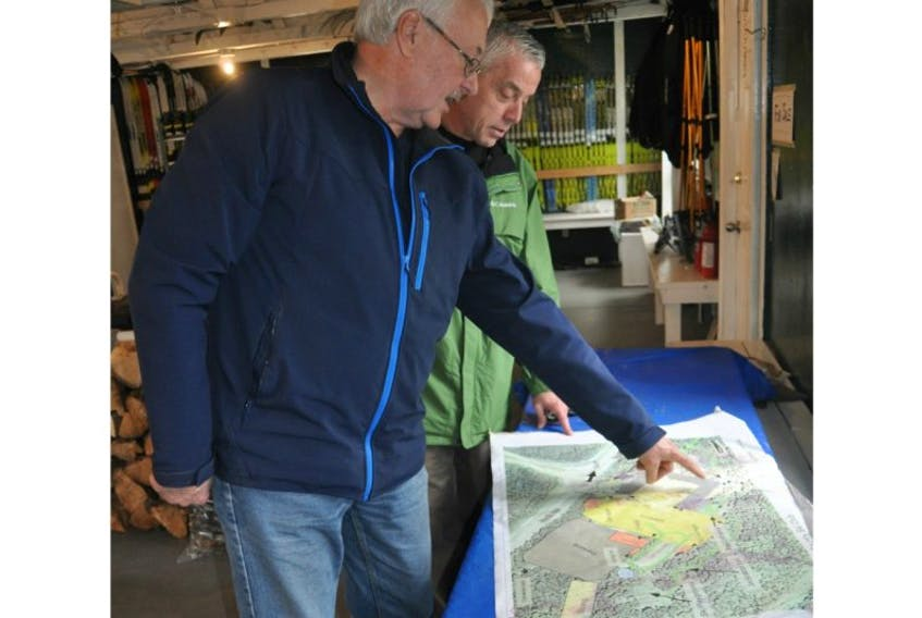 Dave Stoodley, left, and Councillor Mike Browne discuss the plot layout for the improved and expanded cross-country ski, snowshoeing and mountain biking facility in Grand Falls-Windsor.