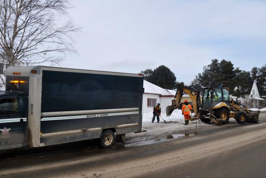 Town employees work on the scene of one of a number of water line breaks in Grand Falls-Windsor of late.
