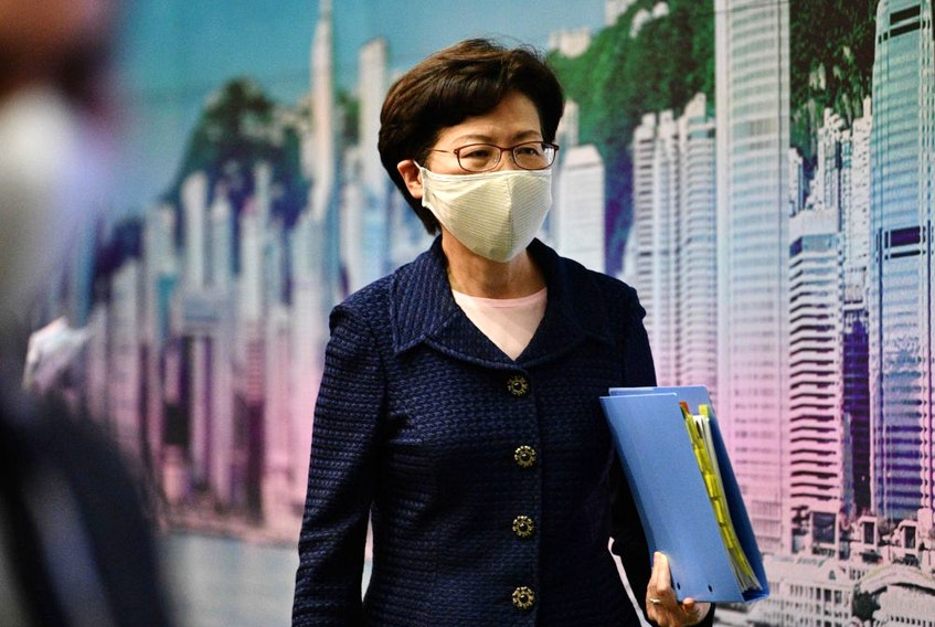 Hong Kong Chief Executive Carrie Lam leaves at the end of a press conference at the government headquarters in Hong Kong on July 31.