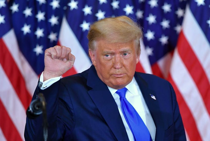 U.S. President Donald Trump pumps his fist after speaking on election night in the East Room of the White House in Washington, D.C., early on Nov. 4.