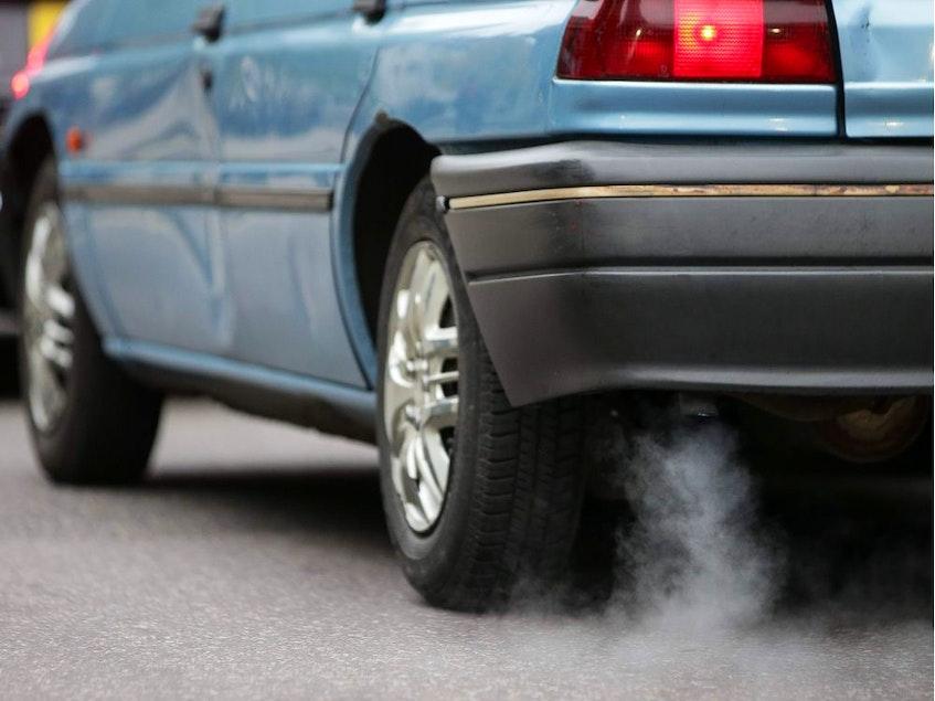 A car emitting exhaust. - 123rf Stock Photo