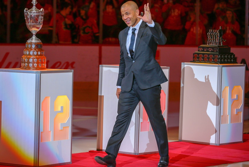 Hockey fans honour longtime Calgary Flames captain, Jarome Iginla, the team's all-time leader in points and games played, by retiring his No. 12 jersey in Calgary on March 2, 2019.