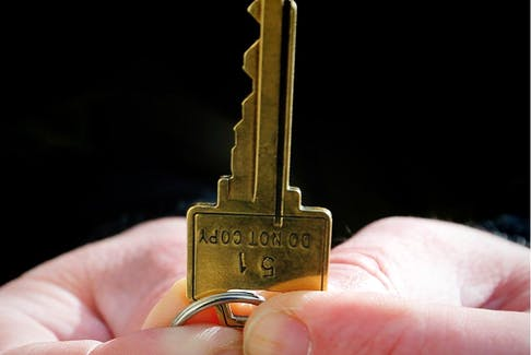 A man holds a key to home