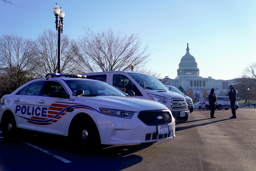 Police vehicles are parked outside the U.S. Capitol Thursday, the day after supporters of U.S. President Donald Trump occupied the building in Washington, D.C. — REUTERS/Erin Scott
