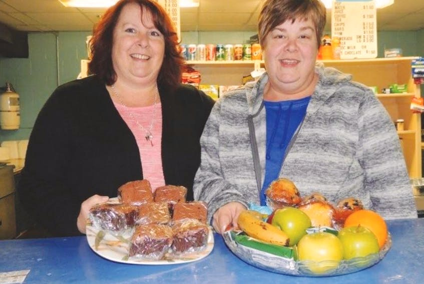 <p>Sisters Lori Morrison and Kathi MacConnell operate the canteen at Pictou's Hector Arena, cheering players on, watching them progress and getting to know the families who are in and out of the rink all winter. It may not be part of the job but they direct visiting teams to the right dressing room, take charge of lost and found items and relay messages for players, parents, coaches and officials. (Rosalie MacEachern photo)</p>