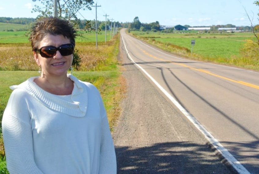 Glenna O'Quinn stands beside Highway 302 near Amherst. She's concerned with the speed and unsafe driving by some vehicles turning onto the highway from Highway 2 in Upper Nappan.