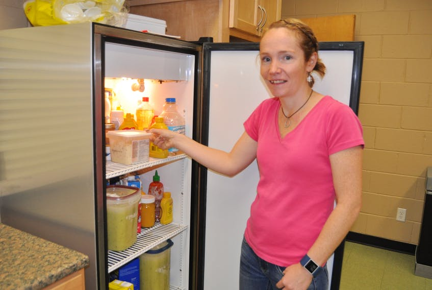 Alison Lair checks the fridge at the Cumberland YMCA in Amherst. The facility will be starting a Community Kitchen program on Wednesdays, starting on Jan. 10, 2018.