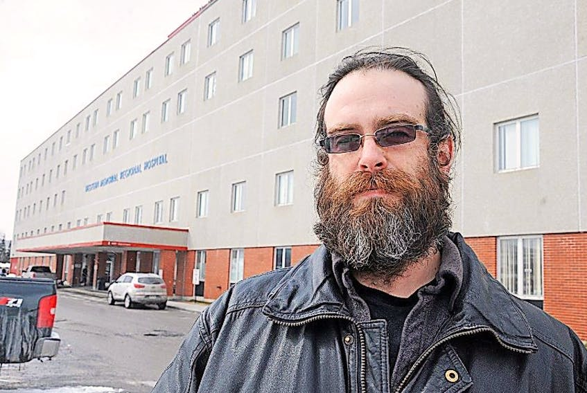 Andrew Abbass poses for a photo outside Western Memorial Regional Hospital in Corner Brook on Wednesday.