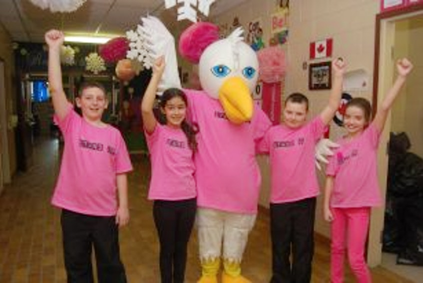 ['Students at Stephenville Elementary School and their mascot Ellie the Eagle pose for a photo as the school participated in anti-bullying activities during the week, including wearing pink shirts on Friday. From left area: Cole Hulan, Jewel Boland, Ellie, Zachary White and Claire McIntosh.<br /><br />']