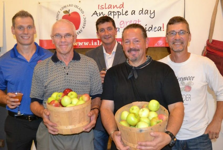 <p>Members of the P.E.I. Apple Growers Association celebrate the opening of apple season with a reception at Wintermoor Orchard in York last Thursday night. From left are Matt Boyle, The Grove, John Brady, Brady's Farm, Richard MacPhee, MacPhee's Orchards, Mark Brunet, Oldetown Orchards, and Mark Ashley, Wintermoor Orchard.</p>