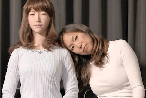 A.rtificial I.mmortality director Ann Shin (right) with Erica the robot.