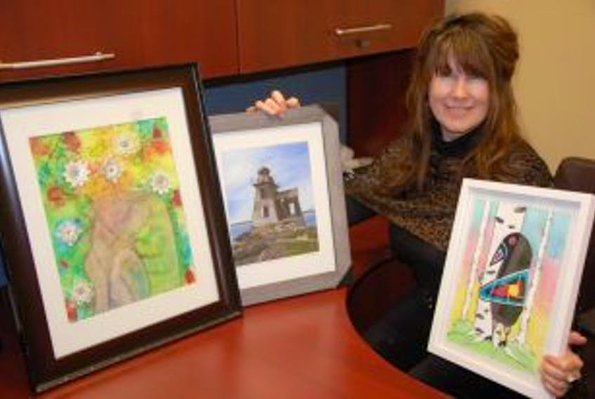 ['<p>&nbsp;</p>\nSummerside artist Catherine Ann Dickson displays some of the artwork that will be up for auction in support of P.E.I. Reach Centre. The centre deals with addictions and families and much of the artwork reflects that effort. Dickson's works involve a bird with a birch tree with the birch representing transformation and renewal. The snowflakes represent the first steps taken towards rehabilitation. The lighthouse, painted by Wendell Cameron represents hope through the darkness.&nbsp;']
