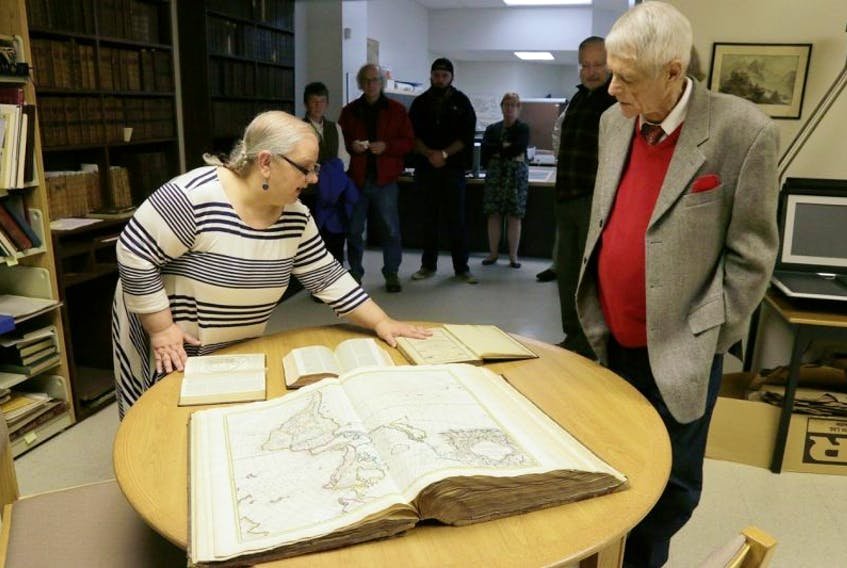 Trish LeBlanc, AVC's librarian provides a tour to visitors of the WK Morrison map collection at COGS December 2. The W. K. Morrison Special Collection of cartographic books and maps, dating back to the 16th Century, are now available online.