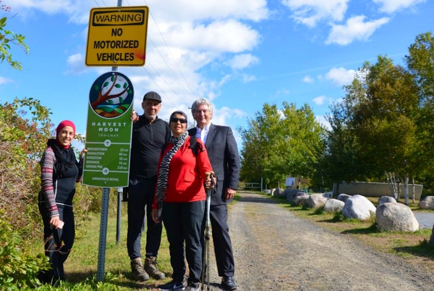 Suha Masalmah, Ismail Cajee, and Fatima Cajee walked the 110 kilometres from Grand Pré to Annapolis Royal along the Harvest Moon Trailway. They were greeted at Annapolis Royal Oct. 5 by the town's Mayor Bill MacDonald.