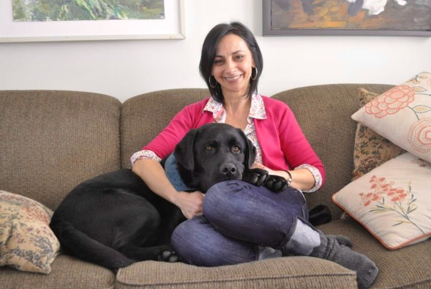 Julia A. Wassef and her therapy dog Figgy Duff relax at home in Avonport