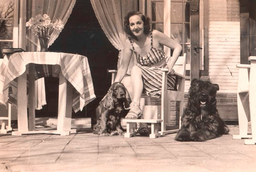 Mona Parsons on the terrace of her home with her beloved dogs.