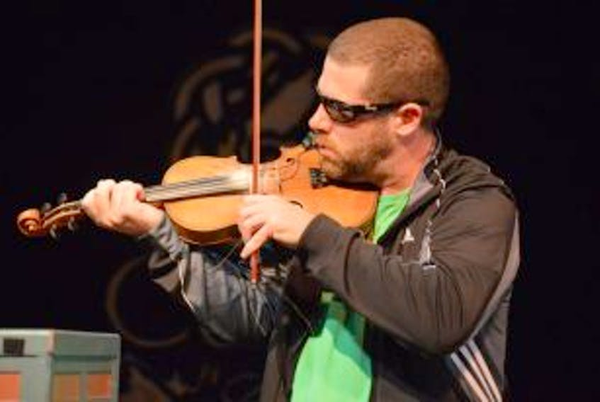 ['In this file photo, fiddler Ashley MacIsaac is shown performing while in Cape Breton in 2015.']