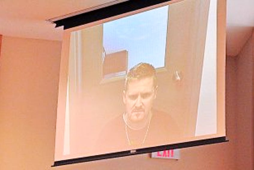 ['Gary Kean/The Western Star<br />Ashley Shannon Park of Corner Brook appeared via video from Her Majesty's Penitentiary in St. John's for his provincial court appearance in Corner Brook on armed robbery-related charges Tuesday.']