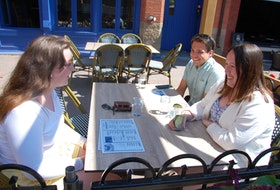 Brianna O-Connor of Cornwall, left, joins Matthew Ferguson of Vernon River and Cassidy Morrison of Belfast at FishBones Oyster Bar and Grill Wednesday on Victoria Row in Charlottetown. The restaurants on Victoria Row are expecteing to benefit from the Atlantic bubble announced Wednesday that will see visitors from Nova Scotia, New Brunswick and Newfoundland able to come to P.E.I. starting July 3 without the requirement to self-isolate.