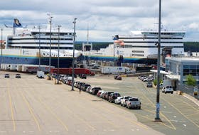 Vehicles are shown lined up at the Marine Atlantic terminal in North Sydney on Friday. More than 30 vehicles were preparing to board Marine Atlantic's MV Blue Puttees for the 11:45 a.m. crossing, the first since the opening of the Atlantic bubble Friday. JEREMY FRASER/CAPE BRETON POST