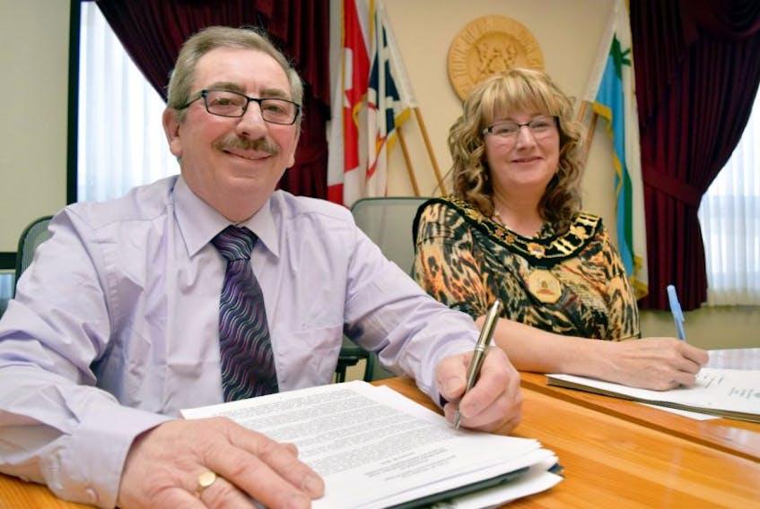 Labrador City Deputy Mayor Junior Humphries and Mayor Karen Oldford pose for a photo after adopting the 2016 municipal budget.