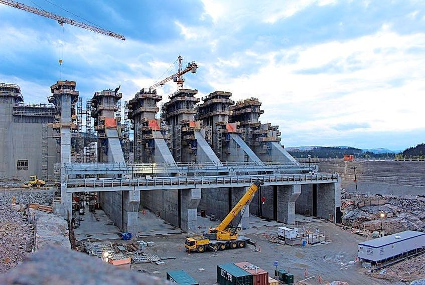 The concrete spillway structure at the Muskrat Falls site is nearly complete. In between each of those gaps, metal gates seven stories high will be installed to control the flow of the river.  On Monday, workers were doing one of the final cement pours of construction on this component; the very last pour was scheduled to happen Wednesday.