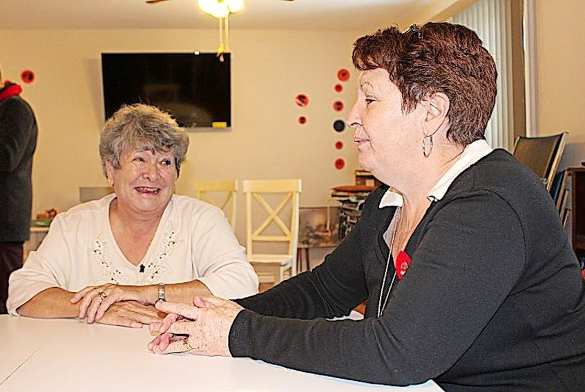 Martha Penney (left) and Noreen Careen of the Labrador West 50-Plus Club welcomed a visit from Liberal leader Dwight Ball, who was out endorsing local candidate Graham Letto on Nov. 4.