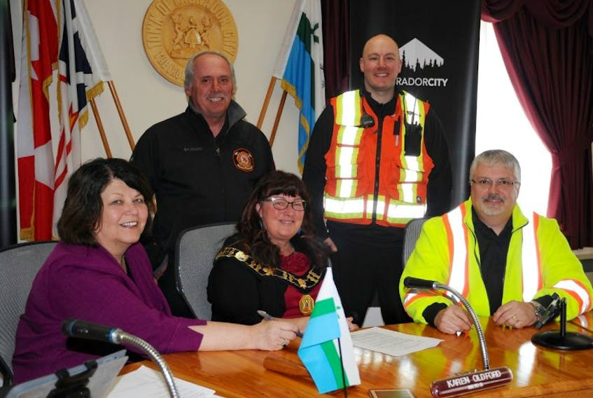 Seated, from left. Heather Bruce-Veitch, Director of communications and external relations for IOC, Karen Oldford, Mayor of Labrador City, Ken Whitten, superintendent of emergency services and security for IOC. Standing, from left, Joe Power, Labrador City fire chief, Rob Parrill.