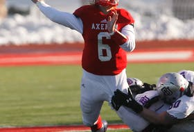 Acadia Axemen quarterback Hunter Guenard evades a tackle by the Bishop's Gaiters during the 2019 Loney Bowl conference championship in Wolfville last Nov. 9.   TIM KROCHAK / The Chronicle Herald