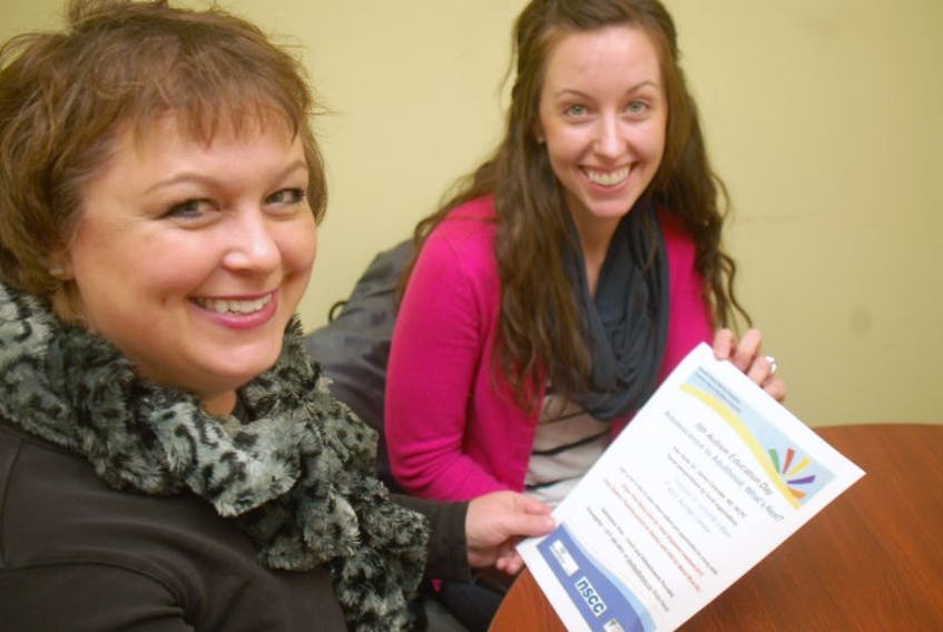 <p>Lisa Doucet, a volunteer with the South West Nova Chapter of Autism Nova Scotia, reviews a poster for Autism Education Day with Cora Day, a fourth-year Dalhousie School of Nursing student.<br />CARLA ALLEN PHOTO</p>