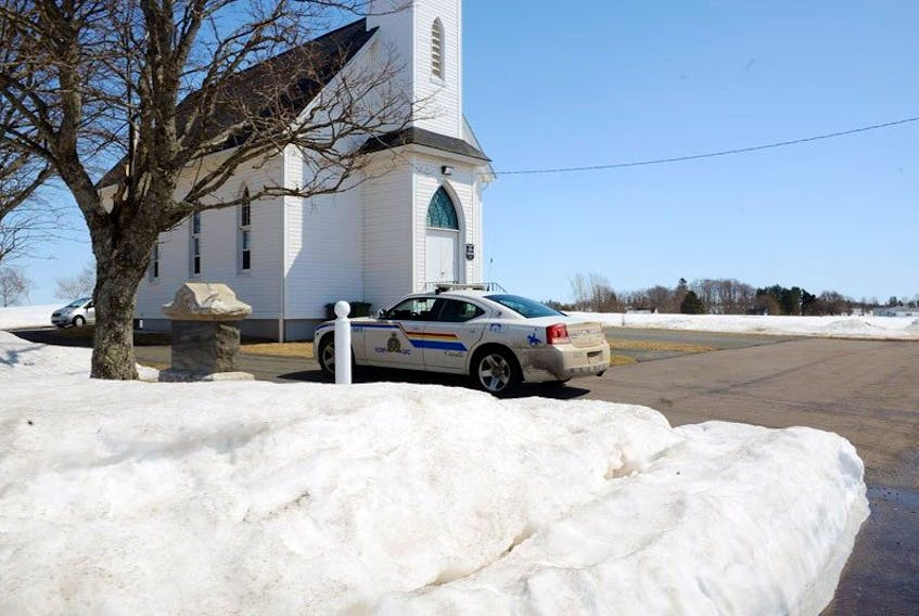 An RCMP patrtol car moves through the driveway of the Birch Hill Free Church of Scotland in this Guardian file photo from April 2015. It was at this church on April 12, 2015 that the body of a newborn was found. The investigation continues.