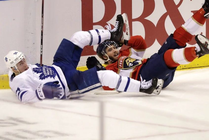 Toronto Maple Leafs defenceman Tyson Barrie takes down Florida Panthers winger Mike Hoffman on Thursday. AP PHOTO
