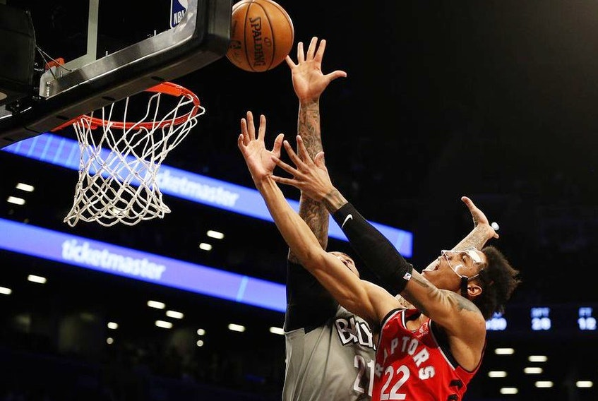 Toronto Raptors forward Patrick McCaw shoots against Brooklyn Nets forward Wilson Chandler during the first half at Barclays Center.