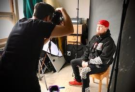 ARTpreneur Dylan Buchanan, right, has his professional headshot taken by Corey Katz. CONTRIBUTED