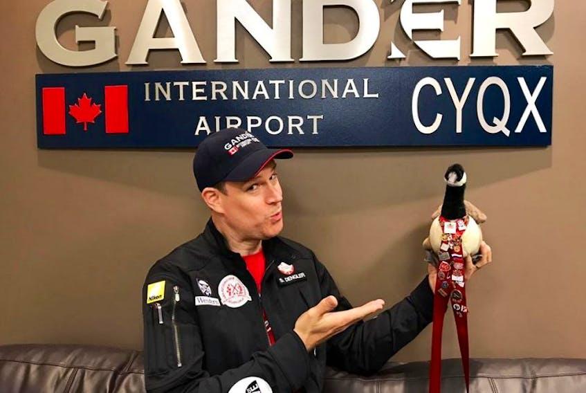 C150 Global Odyssey crewmember Steven Dengler shows off mascot Wawa in Gander.